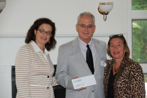Molly Clifford and Bob Crandall accept a Ronald McDonald House Charities check from Carol DeMoulin, RMHC Executive Director